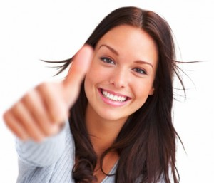 Portrait of attractive young female showing a thumbs up