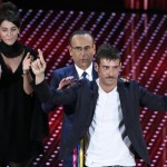 Italian host Carlo Conti (C) with Italian singers Miele (L) and Francesco Gabbani (R) on stage during the Sanremo Italian Song Festival at the Ariston theater in Sanremo, Italy, 11 February 2016. The 66th Festival della Canzone Italiana runs from 09 to 13 February. ANSA/CLAUDIO ONORATI