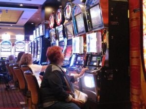 In this June 24, 2016, photo, a gambler plays a slot machine at the Golden Nugget casino in Atlantic City, N.J. On Thursday, Sept. 22, 2016, the men who are proposing to build two new casinos in northern New Jersey near New York City, concluded the statewide ballot question that would authorize the projects will not pass, and ended their financial support for a campaign in its favor. (ANSA/AP Photo/Wayne Parry) [CopyrightNotice: Copyright 2016 The Associated Press. All rights reserved.]